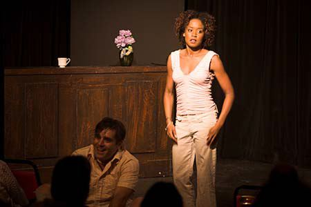 """Eric Webster and Angela Dalton in Sam Post's play, """"Love Poem,"""" produced by Patrick Coyle and The Original Theatre Company at Bryant Lake Bowl in Minneapolis."""